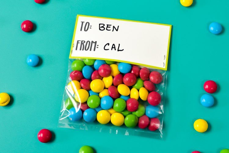 Write the child's name on the back of the treat topper