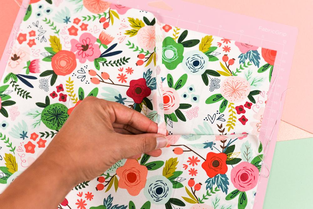 Peeling fabric off mat