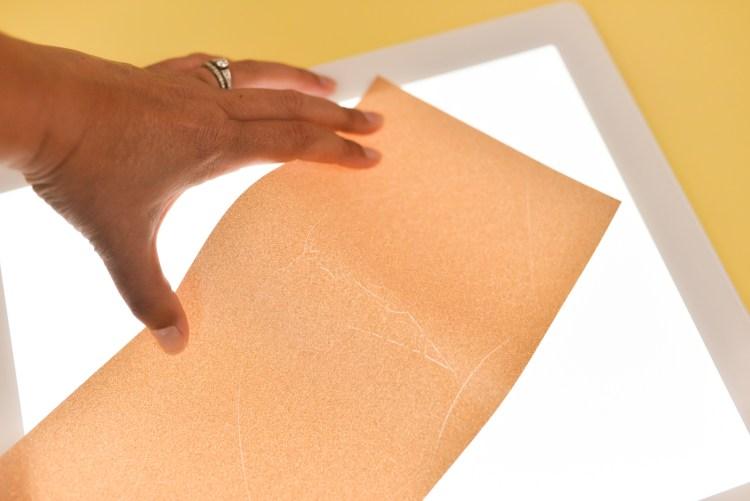 Use the Cricut BrightPad to weed glitter vinyl.