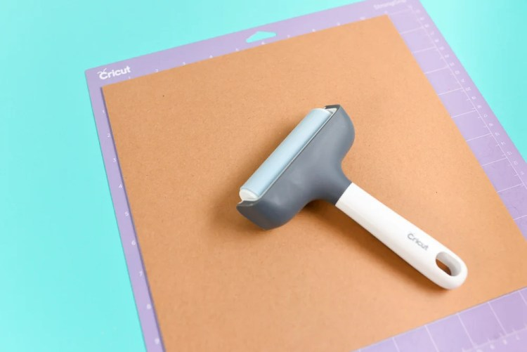 Use a Brayer to secure your chipboard to the mat