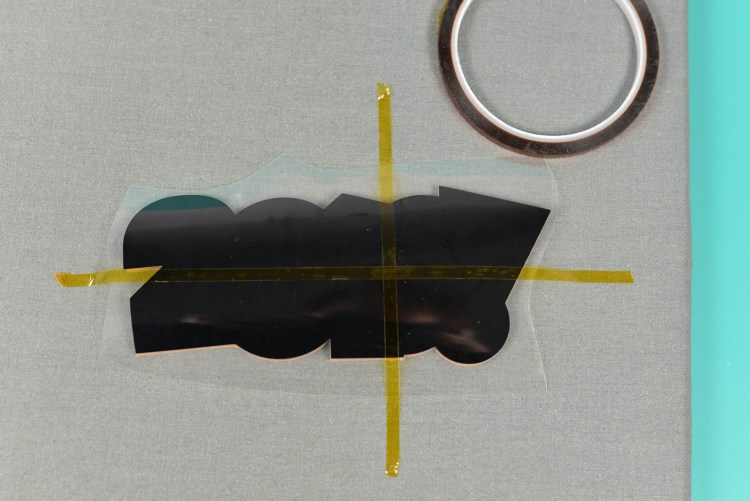 Use heat-resistant tape to help line up vinyl