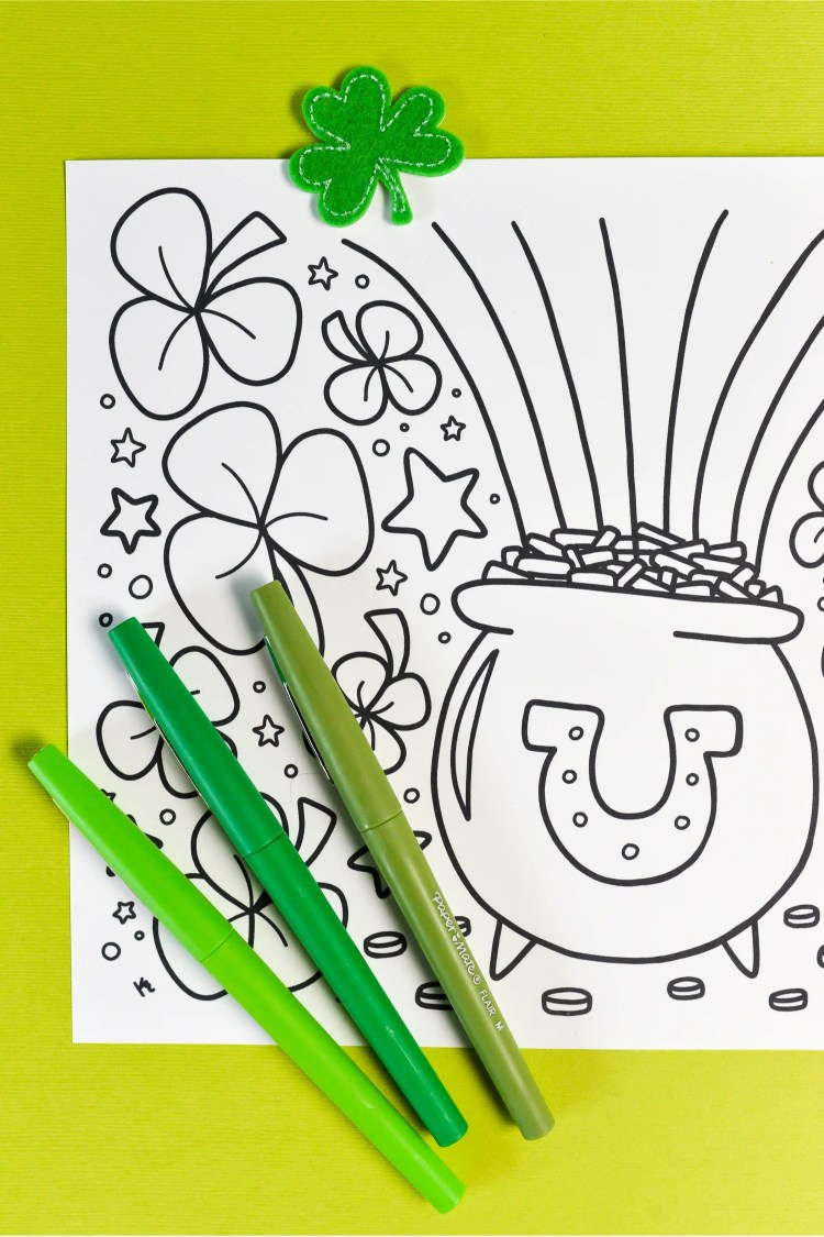 This free printable St. Patrick's Day coloring page is so lucky! A shower of of clovers and shamrocks around a festive pot of gold with a rainbow! Great for celebrating St. Patrick's Day. Print it out for free!