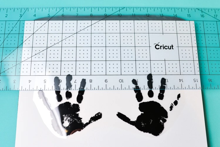 Use an acrylic ruler to help line up your iron on vinyl.