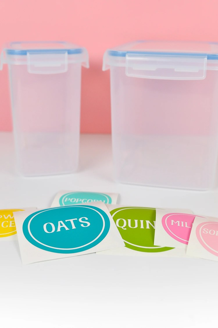 Cut labels in front of blank plastic containers