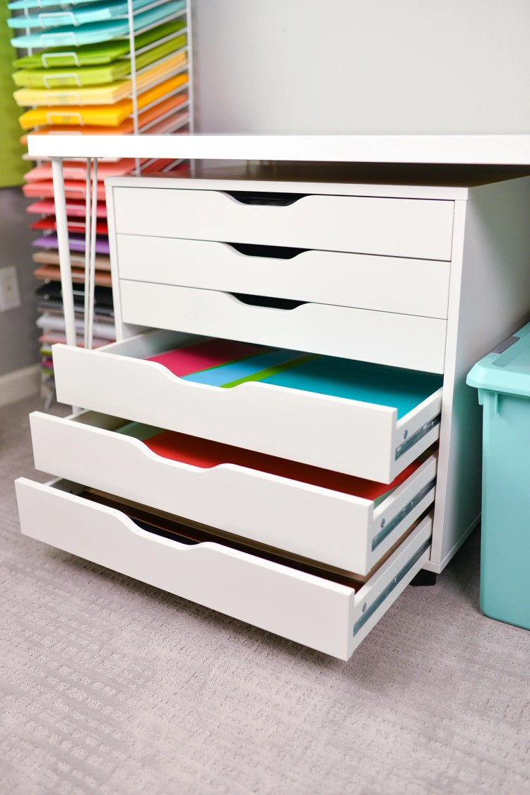 Open drawers with vinyl, no labels.