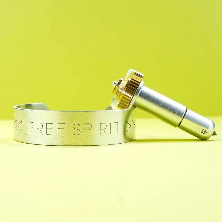 Cricut Maker Engraving Tool and finished engraved bracelet cuff