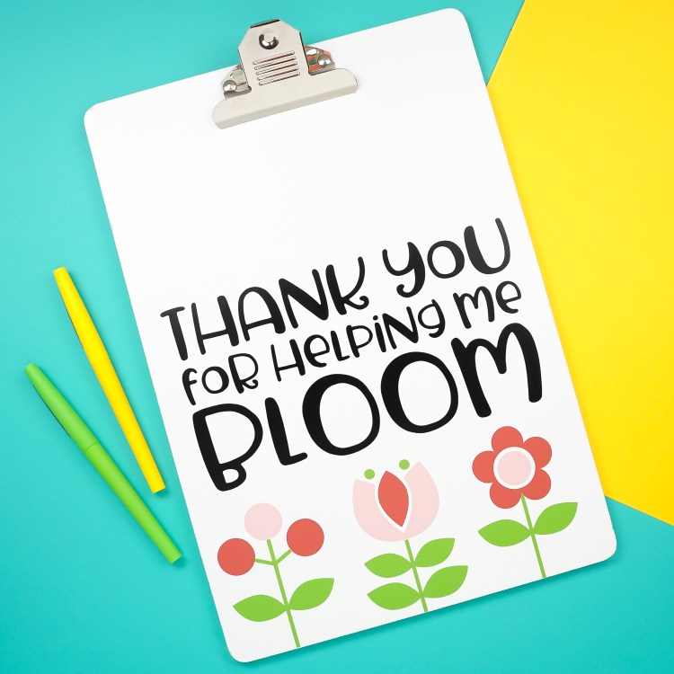 "Say thank you to a favorite educator with this sweet and easy teacher gift idea! Use your Cricut Explore or Maker to make this clipboard, which says ""thank you for helping me bloom,"" along with cute Scandinavian-style flowers."