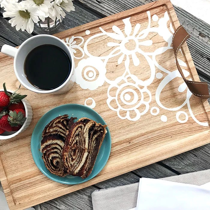 100directions.com shows us how to turn an ordinary serving tray into a decorative serving piece for your kitchen. Your coffee and dessert never looked so good.