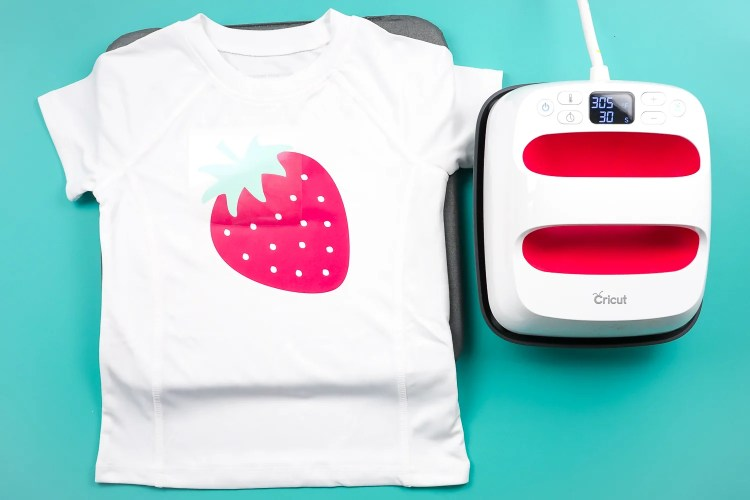 Add the top of the strawberry to the shirt.