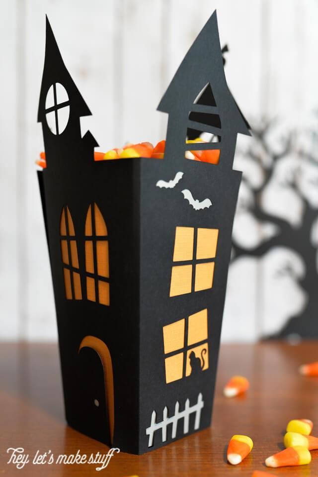 Create this Haunted House Cut Paper Candy Box from heyletsmakestuff.com and fill it up with your favorite Halloween treats.