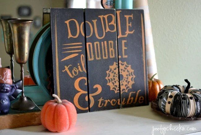 Get crafty and make your very own Toil & Trouble Mini Pallet Halloween Sign from poofycheeks.com.
