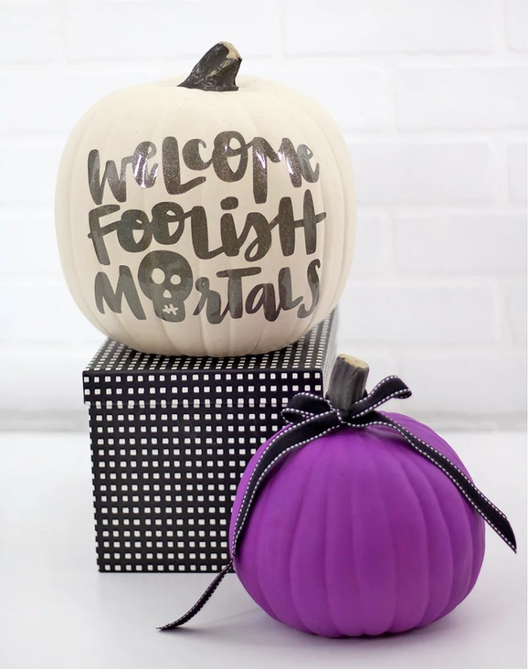 If you want to skip the pumpkin carving this year, try decorating with this Haunted Mansion inspired pumpkin craft from persialou.com.