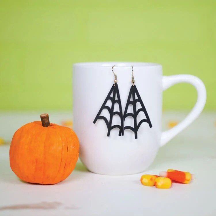 These DIY spider web earrings from heyletsmakestuff.com can be cut on your Cricut or other cutting machine using faux suede or leather. This Halloween accessory project comes together in less than 10 minutes!