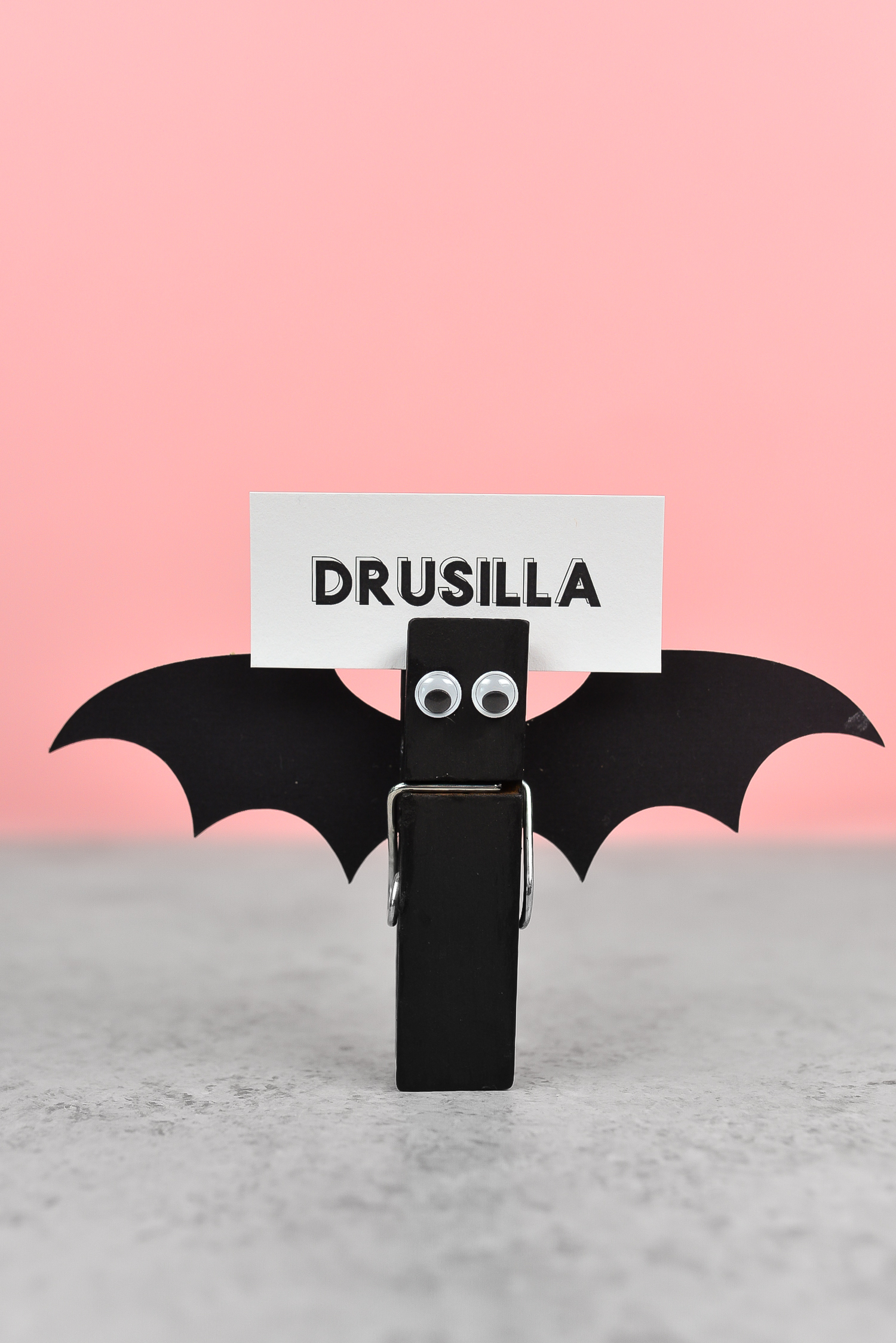 These bat nametags are super simple to make—just cut out the wings and attach them to a clothespin with googly eyes. They're Halloween place cards that everyone will love!