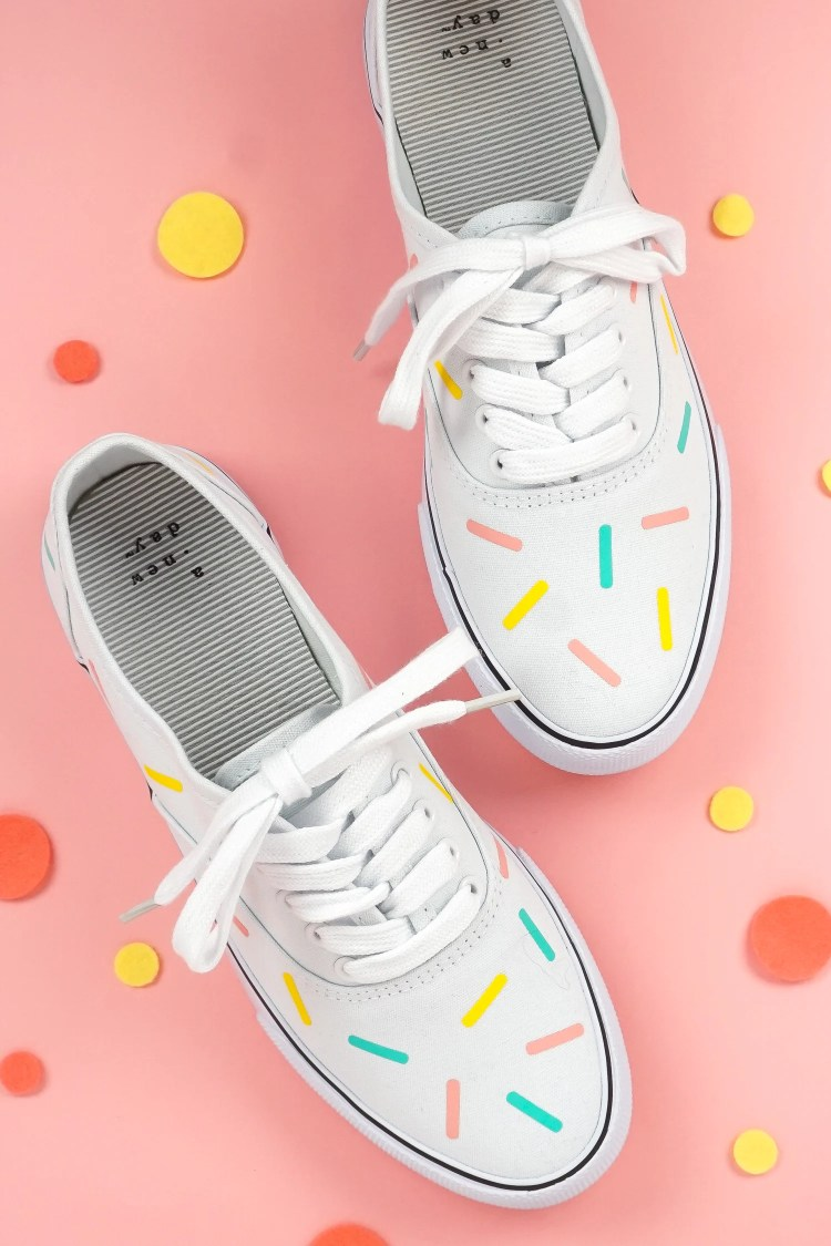 The new Cricut EasyPress Mini makes it easy to make projects like these sprinkle iron on shoes! The small pressing plate and even heating work great on curved surfaces and over seams.