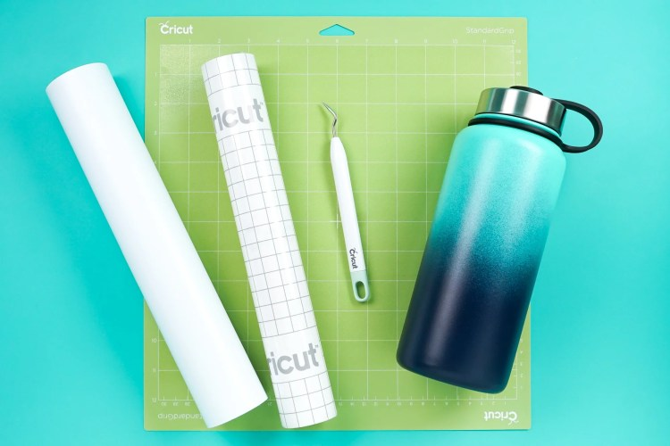 Supplies needed to make a water bottle with adhesive vinhyl.