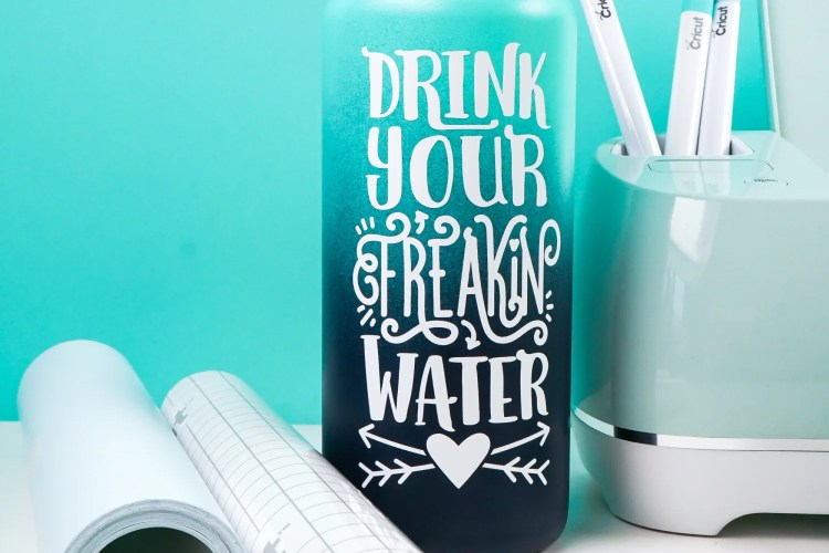 Here are step by step instructions on how to use adhesive vinyl to make a water bottle decal! Learn tips and tricks for cutting and weeding your adhesive vinyl, as well as adhering it using transfer tape.