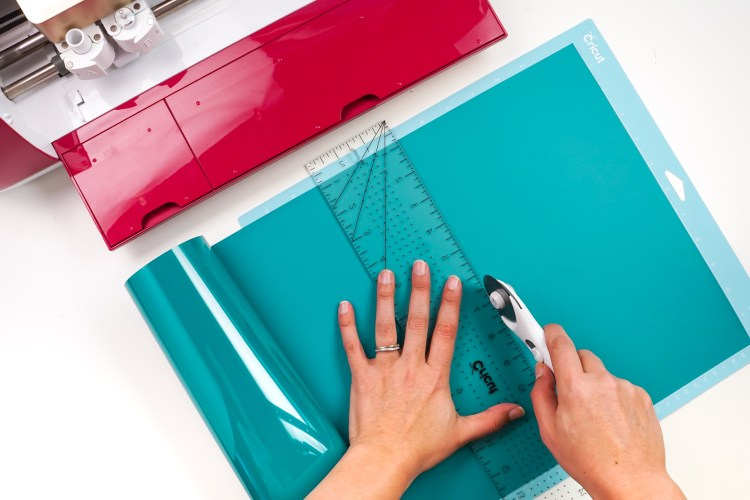 Use a rotary cutter to trim the excess vinyl