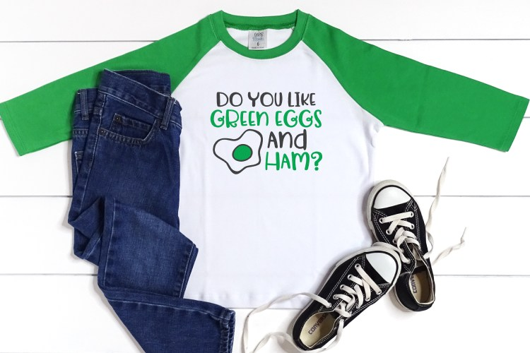 """Do you like Green Eggs and Ham"" SVG on a green raglan shirt"
