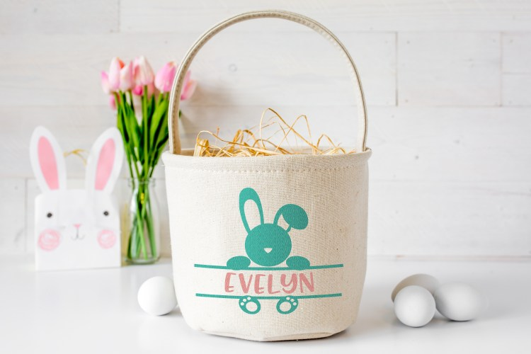 Easter monogram SVG on a canvas easter basket with the name Evelyn