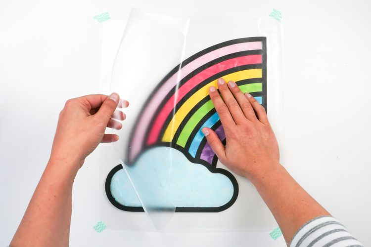 Place the second piece of contact paper on top of the rainbow, starting in the center.
