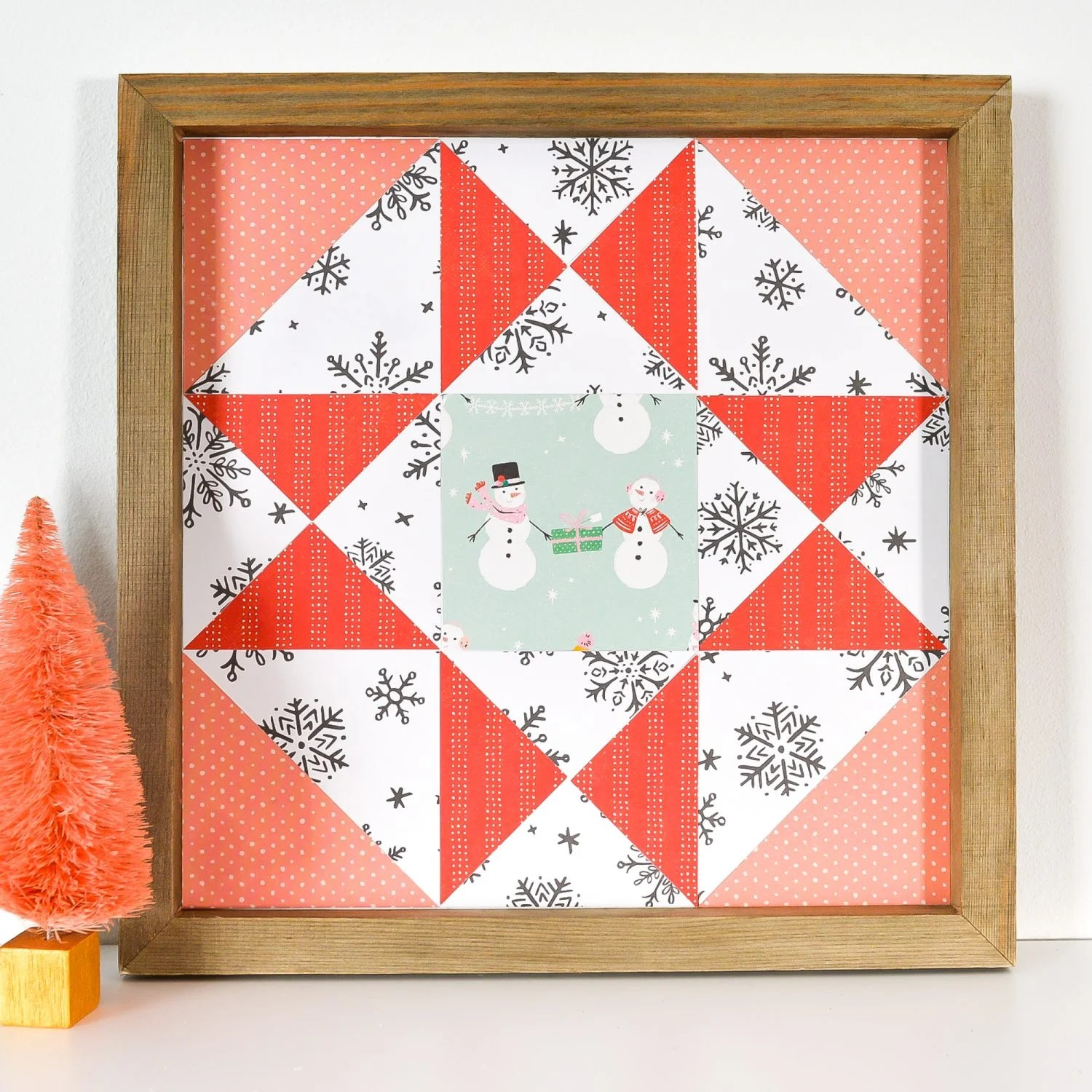 Christmas Paper Quilt Block on shelf with faux tree decor