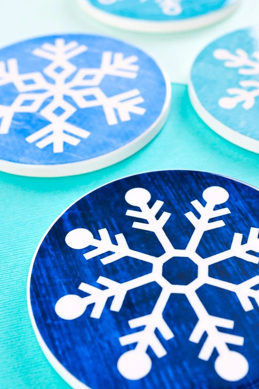 Closeup of four Christmas coasters at an angle.