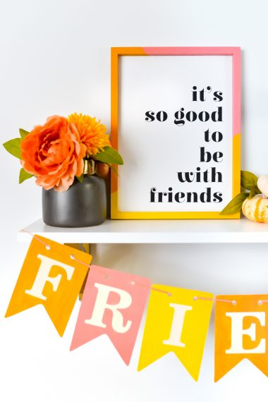 """Closeup of """"it's so good to be with friends"""" sign"""