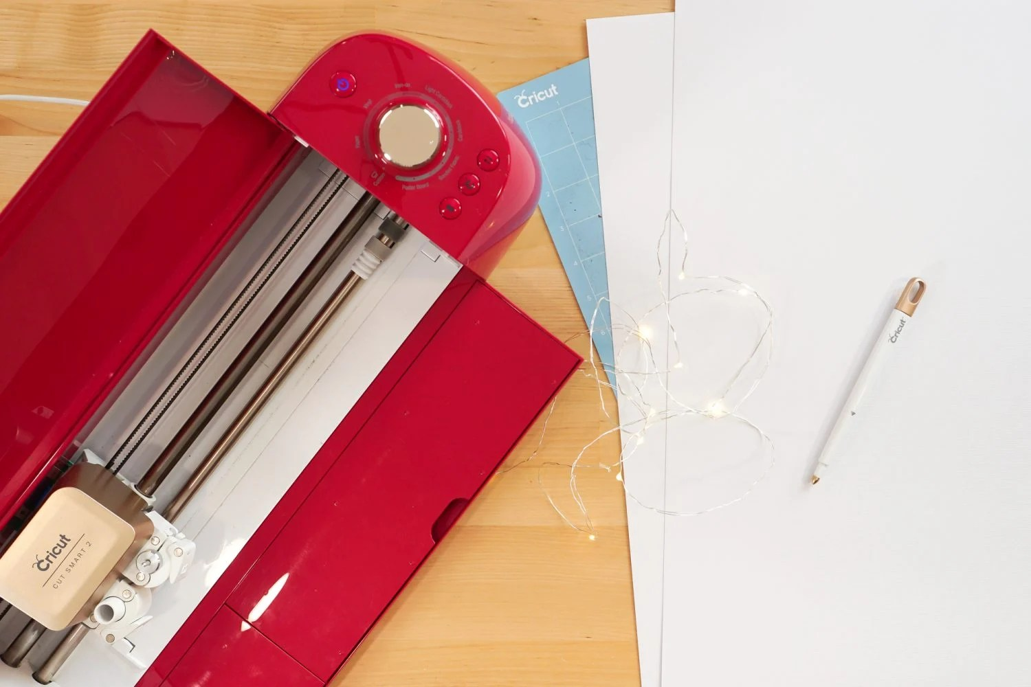 """Supplies needed for this project: Cricut Explore, 12"""" x 24"""" cutting mat, 12"""" x 24"""" white cardstock, scoring stylus, fairy lights"""