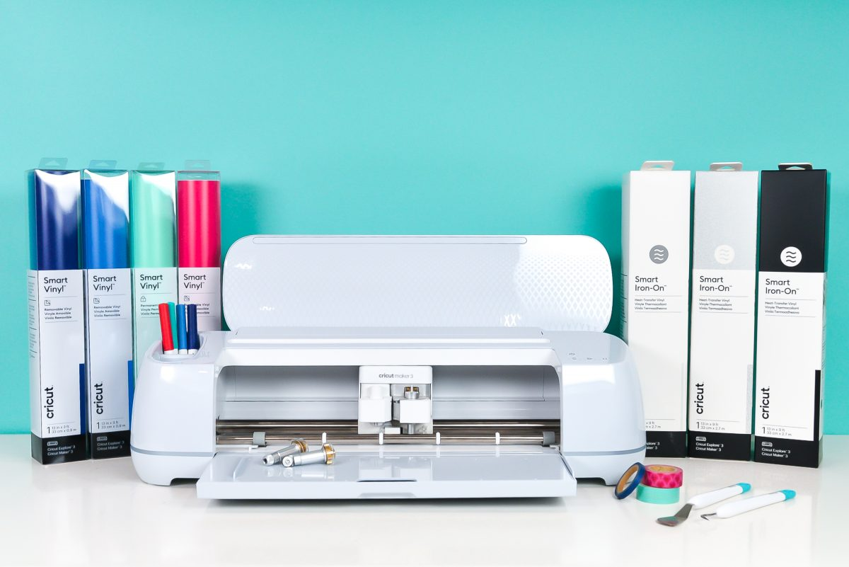Open Cricut Maker 3 on table with materials, supplies, and blades.