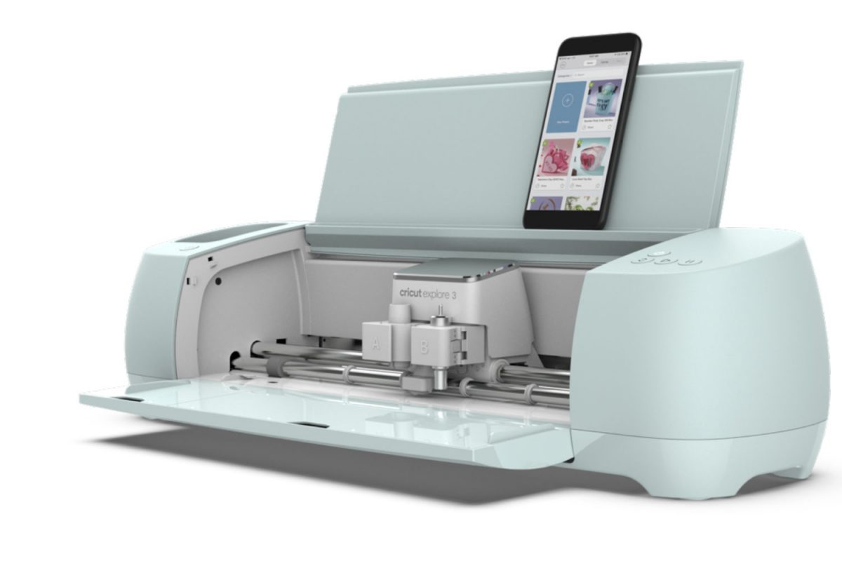 Cricut Explore 3 with mobile phone set into slot and leaning on lid