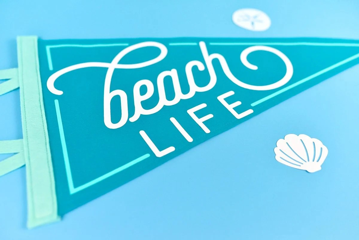 Angle vies Beach Life Pennant on blue background
