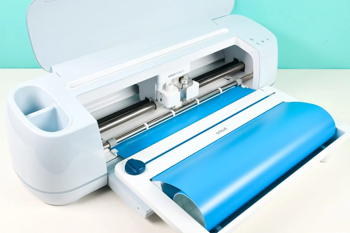 Cricut Maker 3 with Roll Holder attached -- shot at an angle
