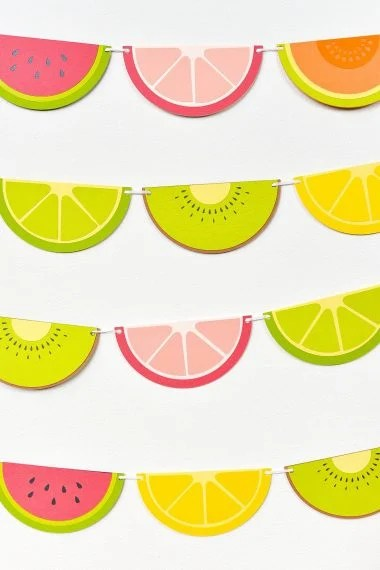 Finished fruit slice banner hanging on a white wall.