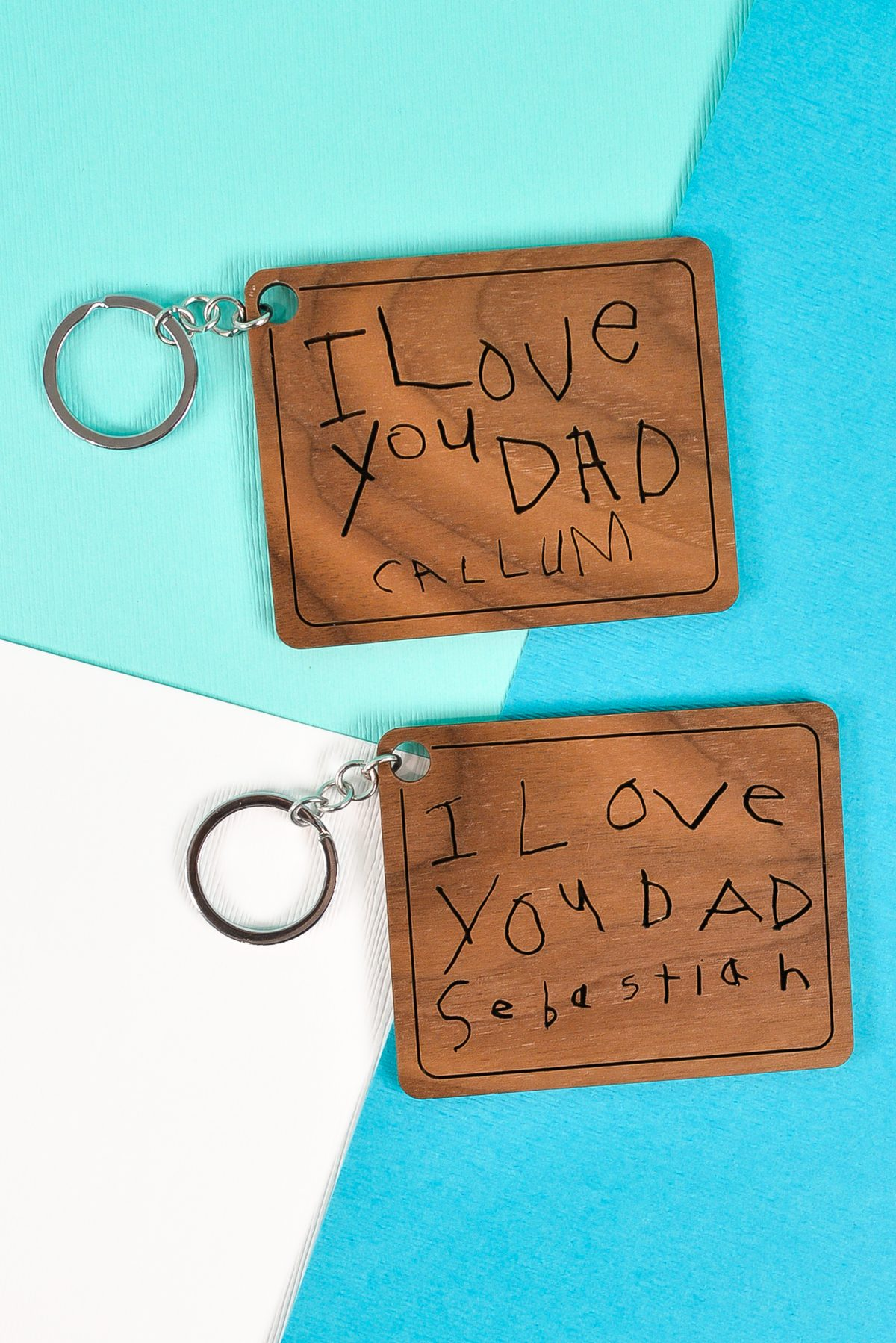 Finished keychains with child's handwriting made on a Glowforge