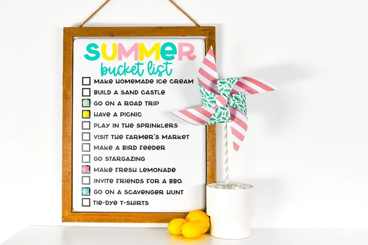Finished summer bucket list board staged with lemons and a pinwheel.