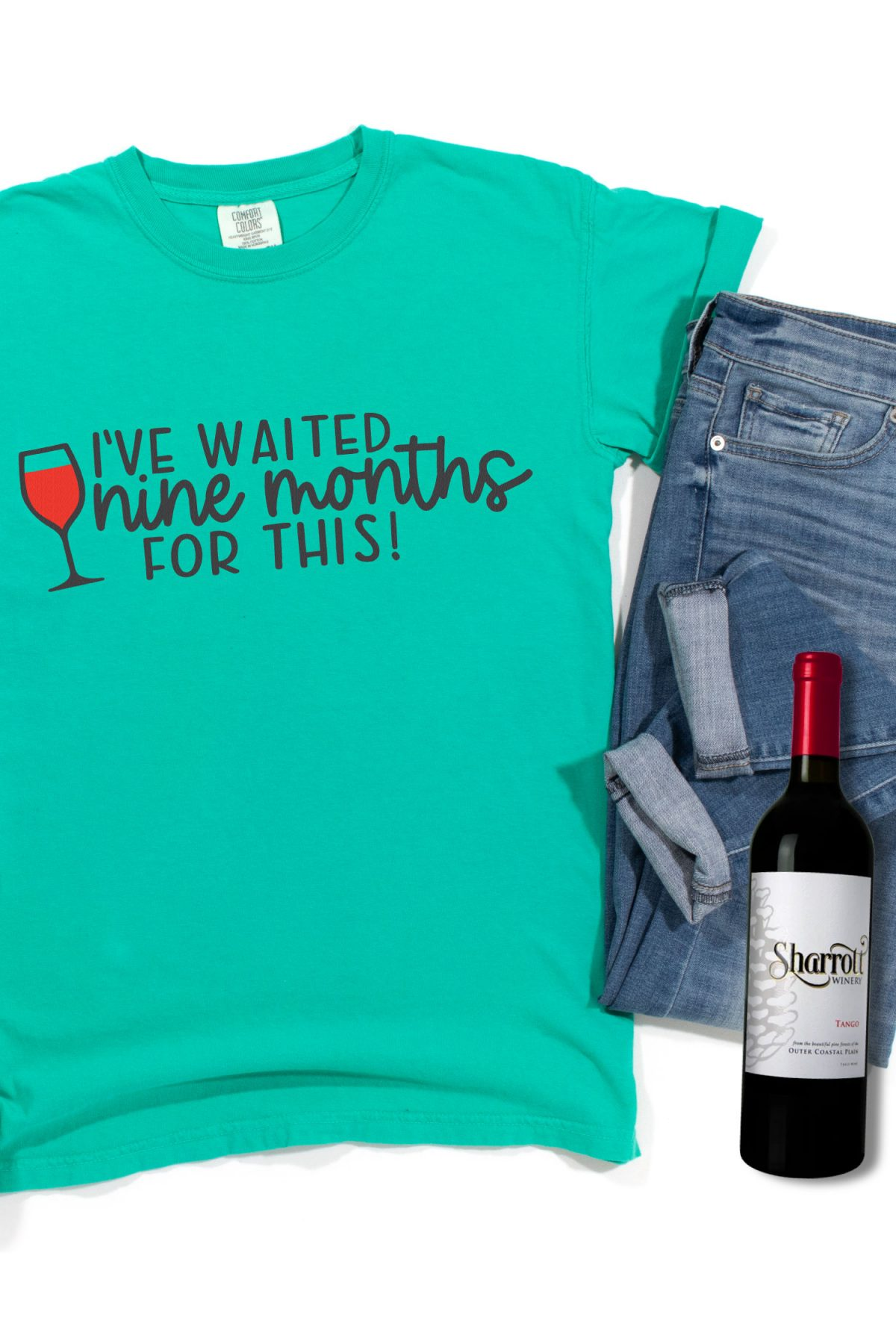Free wine SVG on teal shirt with wine bottle and jeans