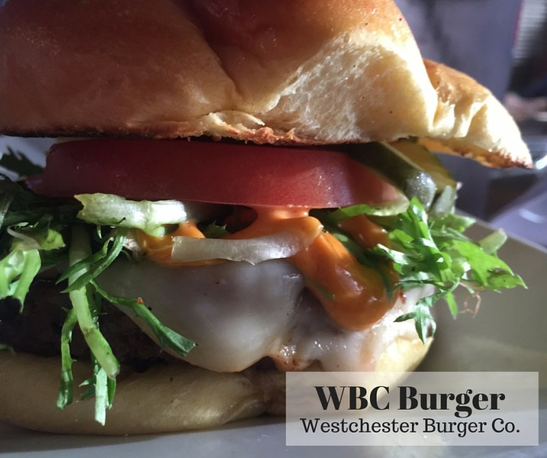 Westchester Burger Co: WBC Burger; signature 10 oz. with WBC sauce, smoked mozzarella, beefsteak tomato, pickes and frisee on brioche