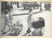 History Mystery Photo #15 The Heyworth Public Library holds in its archive this picture. It is from a parade connected with the Heyworth Community Recreation Association that was organized around 1948. The picture was taken in Heyworth, c. 1948. If anyone has information as to who the girls parading their doll buggies may be, we would love more information. Or do you know what business is in the background? What was its name, who was the owner, and if it was a store - what did it sell? Please let the library know any clues you can uncover for us. 473-2313.