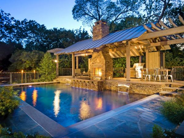 outdoor kitchen with pool and patio 7 of Our Favorite Outdoor Cooking and Dining Areas | HGTV