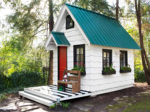 Tiny Houses with Blue Roof Black Trim and Red Door with Black and White Striped Porch