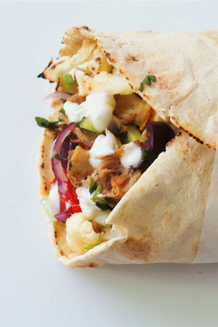 Healthy chicken wrap with cauliflower, tzatziki and vegetables! This is an easy healthy dinner recipe that you can also meal prep - instructions for the meal prep option included in the recipe. This wrap would also be good for healthy lunch, but make sure to follow the meal prep instructions as it would get soggy if you prepare it the night before or in the morning. With a recipe like this it's easy to eat clean, even when you're not motivated at all!