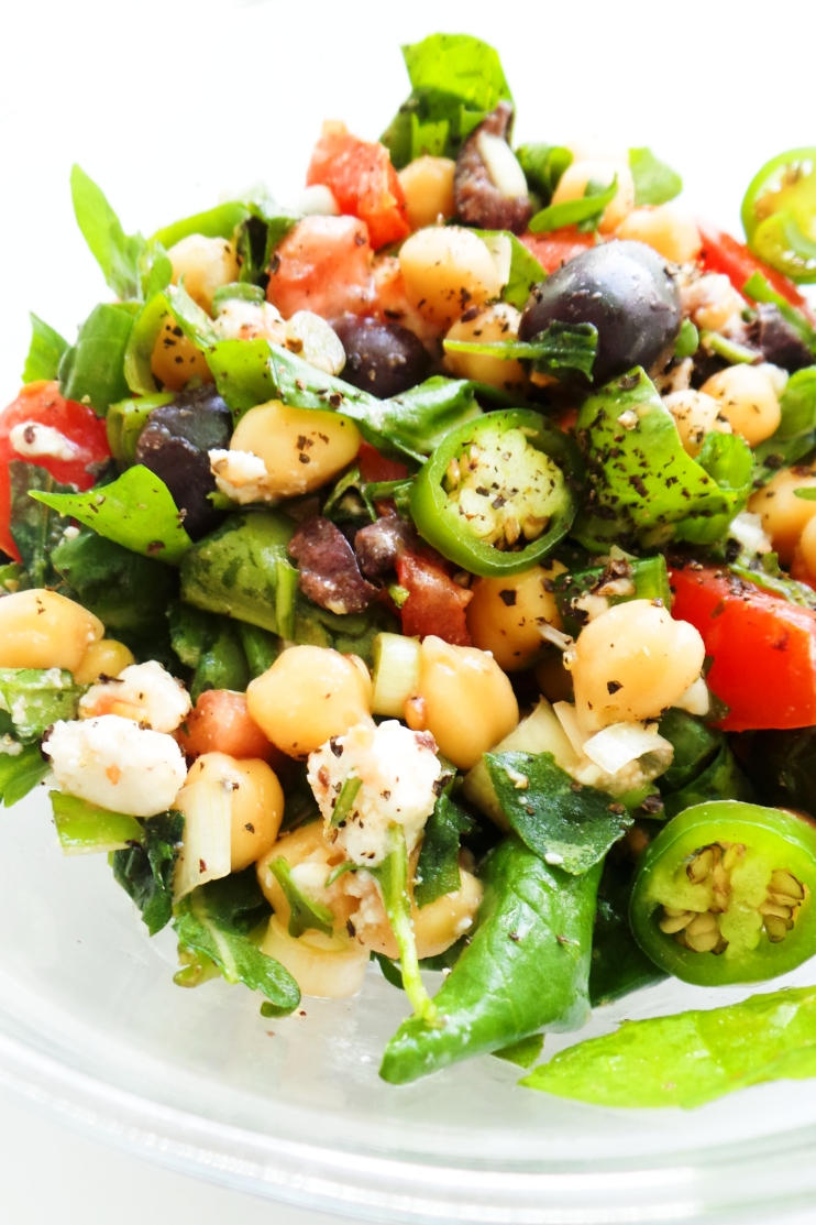 Chickpea salad - the perfect summer salad filled with fresh vegetables, chickpeas, olives and feta cheese! This healthy salad is refreshing, simple, filling, easy to make and full of flavor! A great healthy meal that will be great for lunch or as a side dish with dinner. This salad recipe is vegetarian and gluten-free.
