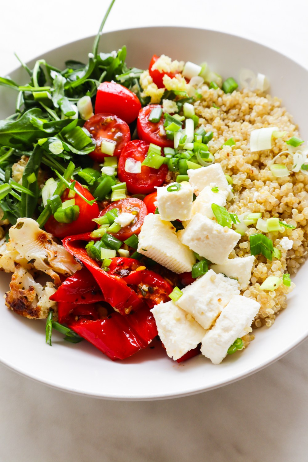 This healthy quinoa salad with feta and roasted vegetables is packed with flavor, fiber and antioxidants! The perfect summer lunch idea! Meal prep the quinoa and roasted vegetables and you can make this healthy meal in 5 minute for a quick & easy lunch!