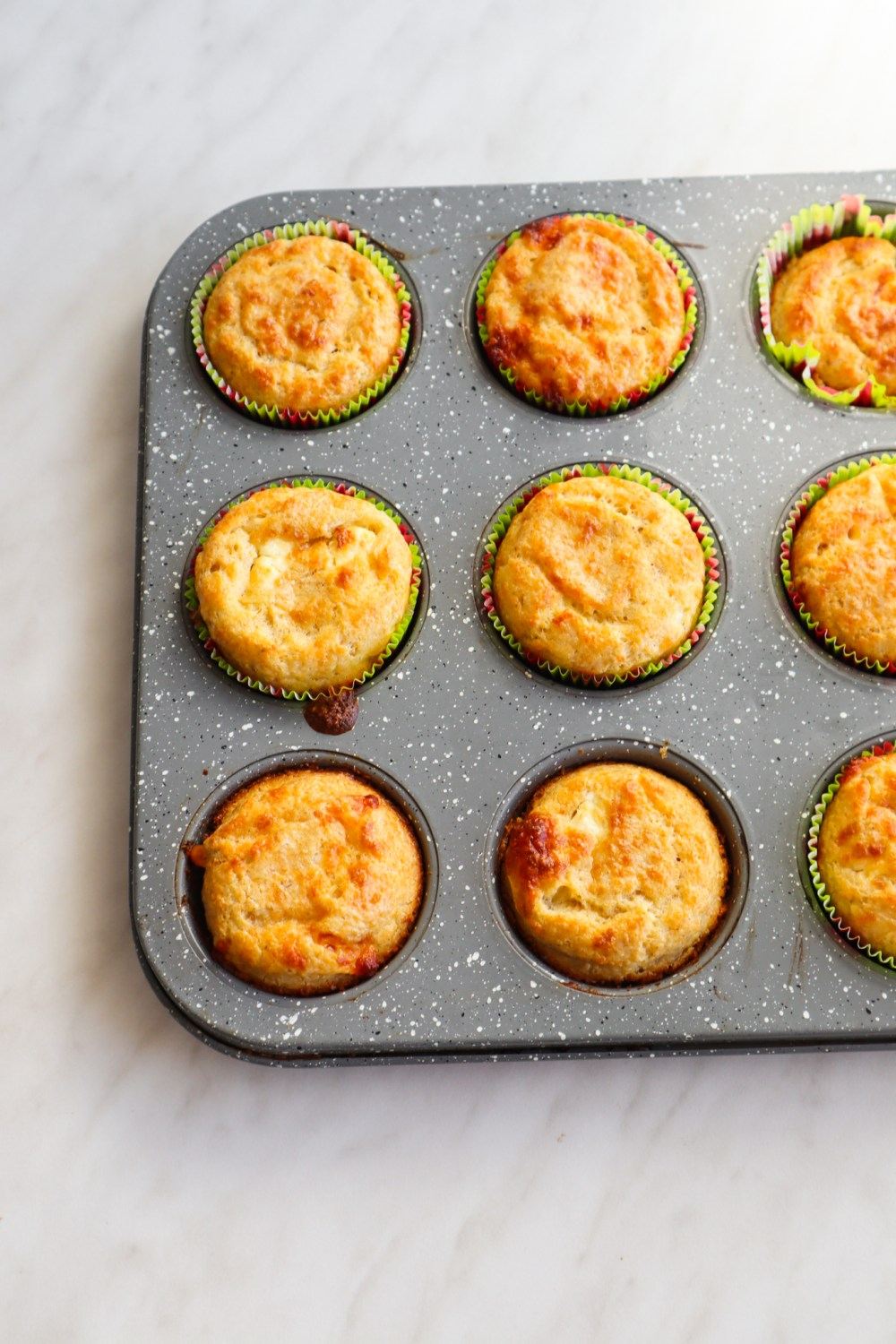 Flourless savoury oatmeal feta muffins! This easy savoury breakfast muffin recipe is simple, gluten free and so delicious! If you're looking for some new easy meal prep breakfast ideas, you've got to try these feta muffins!