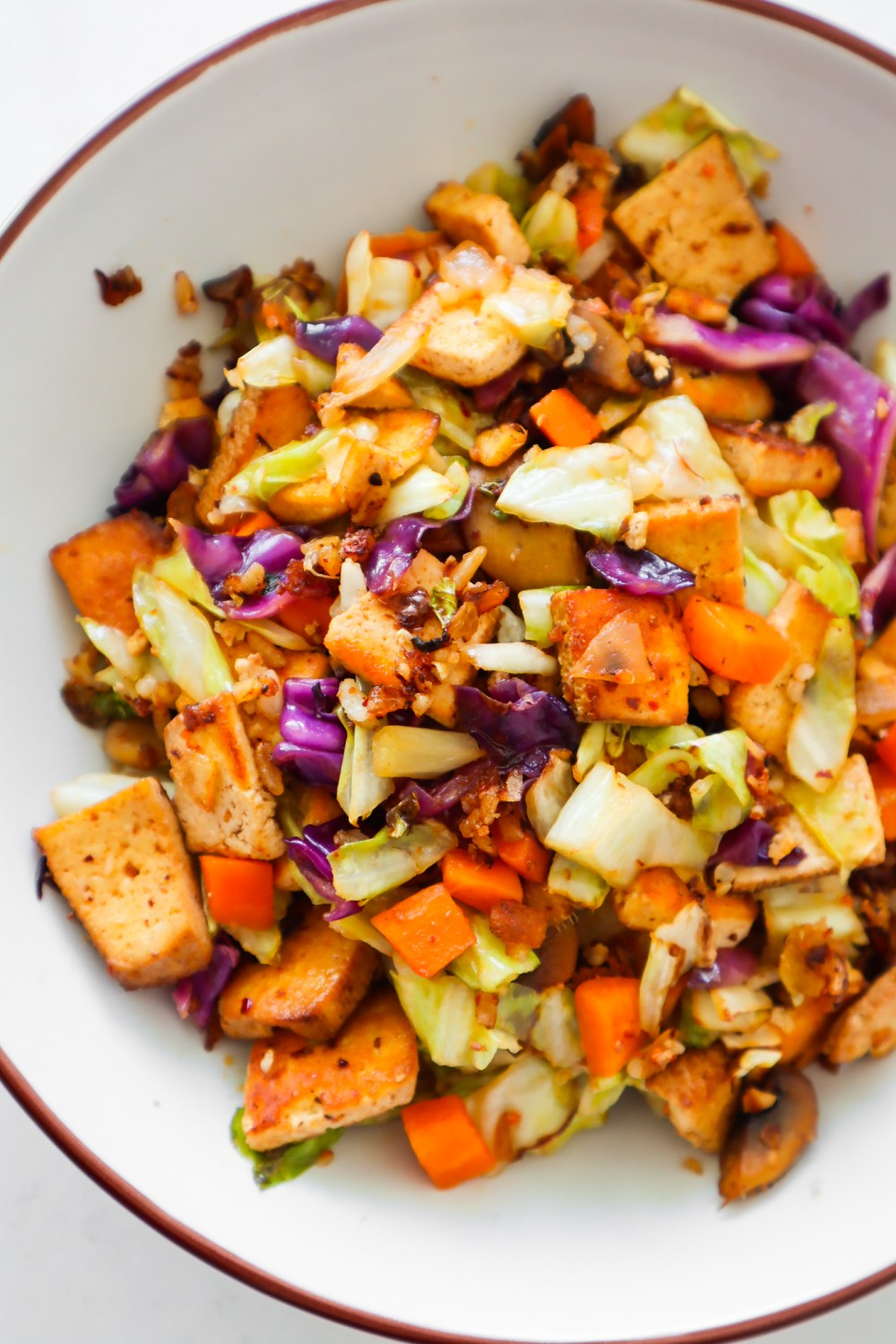 Easy cabbage tofu stir-fry: A vegan cabbage recipe that you will absolutely love! This healthy vegan dinner idea is perfect for busy weeknights, flavorful, delicious and made with cabbage, tofu and more vegetables in about 20 minutes. If you're looking for some no meat gluten-free high-protein recipes, you should try this tasty vegan stir-fry!