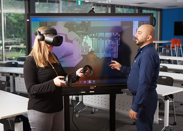 BIM specialists, Melissa Parry and Steve Yilmaz using Virtual Reality Modeling Software Application