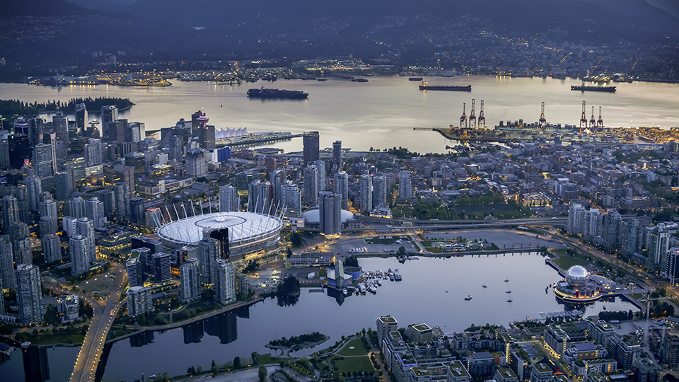 Exterior of BC Place and Science World with modern cityscape and harbour, Vancouver, British, Columbia, Canada.