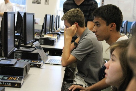 Programming Club members work on chat client workshop project
