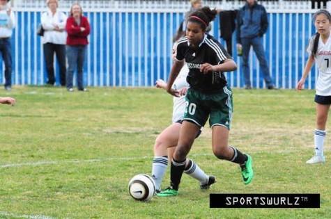 Yannah Melle playing for the Homestead Soccer team.